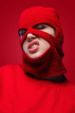 Displeased female in red mask
