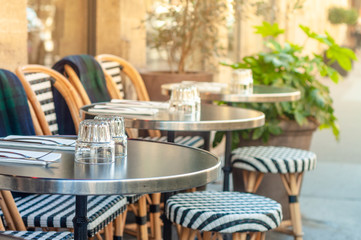 Charming parisian sidewalk cafe,outdoor tables, Paris, France Wall mural
