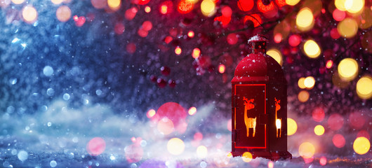Wall Mural - Winter Decoration with a Candlestick Near and Colored Lights and Snow Effects. Christmas Background