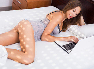 woman in bed with laptop