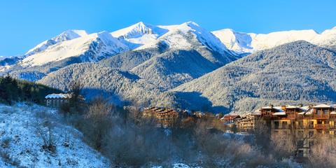 houses and snow mountains landscape sunrise panorama in bulgarian ski resort Bansko, Bulgaria