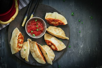 Homemade Nepali Momos Dumplings served with Tomato chutney, Overhead view