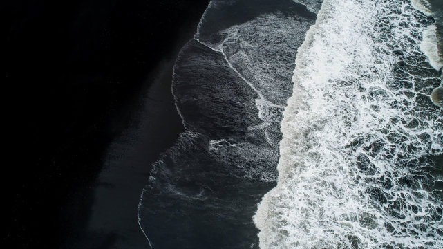 The black sand beach in Iceland. Sea aerial view and top view. Amazing nature, beautiful backgrounds and colors.
