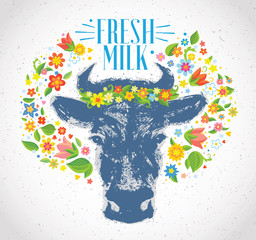 Cows head, in the form of a stain in a graphic style, in surrounded by a wreath of flowers and herbs.