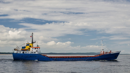 GENERAL CARGO SHIP - Freighter is sailing on the sea