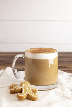 Gingerbread Latte in a Clear Mug with Cookies on the Side