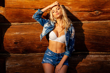 Young beautiful sexy blonde woman in jeans clothes