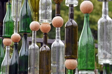 Detail of structure made of empty wine bottles and cork balls