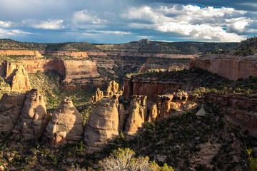 "Warm sunset light on the ""coke ovens"" formations and massive walls of Monument Canyon at Colorado National Monument"