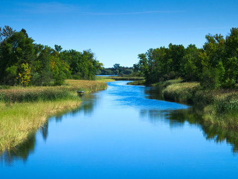 Mississippi River flows north toward Bemidji Minnesota near hiway 2. This scene is a few miles from the source at Lake Itasca
