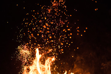 Fiery fire isolated on black isolated background . Beautiful yellow, orange and red fire flame texture style.