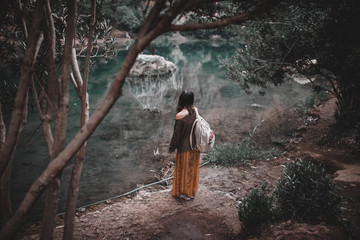 Woman with backpack at lake