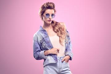 Sensual Blonde model woman in Studio.Trendy Outfit