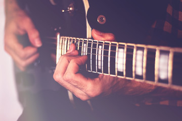 Playing elecreic guitar close-up