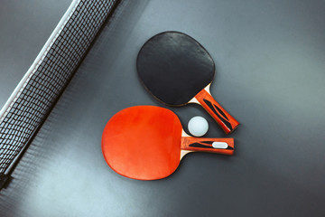 Ping-pong table with rackets and tennis ball