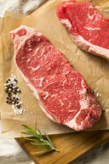 Wall Mural - Raw Grass Fed NY Strip Steaks