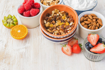 Healthy eating, paleo gluten free nut and fruit granola served with fruits and berries, nut milk, copy space, selective focus