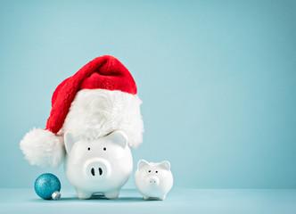 Christmas finances piggy bank wearing santa hat
