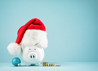 Christmas Holiday piggy bank wearing santa hat