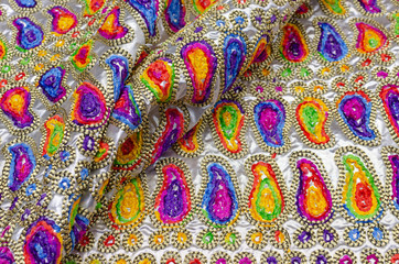 Embroidery from multi-colored ornaments of buta on fabric