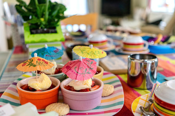 home made cakes on a table with cocktail umbrellas