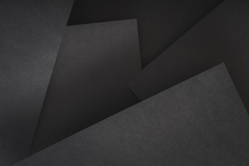 paper layers. abstract geometric background with copyspace. black color shades.