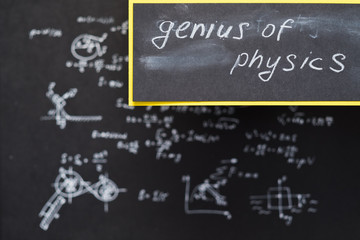 genius of physics. exact sciences and academic research. blurred formula written on chalkboard.