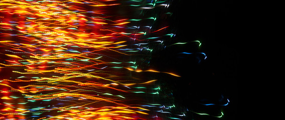 Neon sparks on a dark background. Abstract dark background.