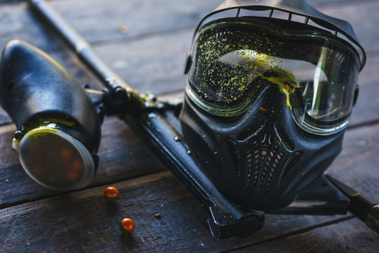 Special protective mask for playing paintball with traces and spot of hit of a ball with paint.