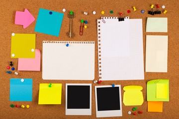 Blank Post It Notes, Photos And Pins On Pinboard Close-up