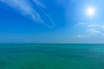 Tropical sea and blue sky with sun.