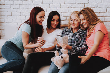Women Watching Photo with Family and Friends.