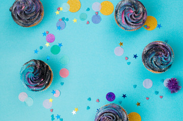 Vanilla cupcakes on party background with copy space