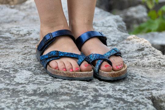 Woman's feet wearing sandals