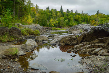 Reflection in the water of the St. Louis River at Jay Cooke State Park in Minnesota