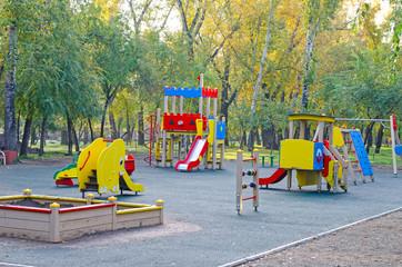 Children's playground in the public park. Russia. Autumn.