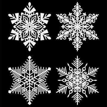 White Snowflakes - Set of 4 beautiful white snowflakes isolated on black background