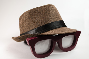 brown tone hat over a large lenses.
