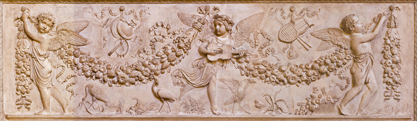 REGGIO EMILIA, ITALY - APRIL 14, 2018: The relief of angels in the symbolic paradise in church chiesa di San Francesco by unknown artist.