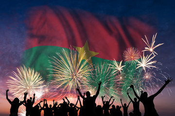People are looking on fireworks and flag of Burkina Faso