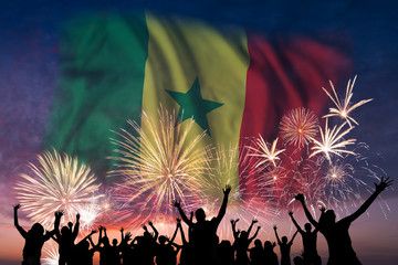 People are looking on fireworks and flag of Senegal