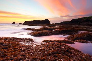 Beautiful sunset at orange or red algae on Melasti beach in bali indonesia island