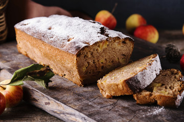 Homemade Apple Cinnamon Coffee Cake with fresh apples on old rustic wooden table. Selective focus