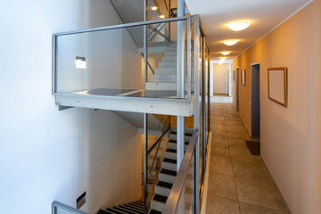 Modern stairs with glass parapet in modern condominium