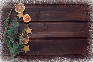 New Year's Christmas snow background with oranges and stars of a Christmas tree