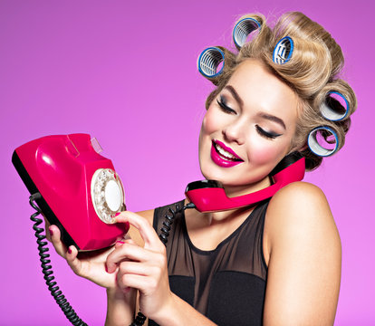 Young girl dials a phone number on an old phone