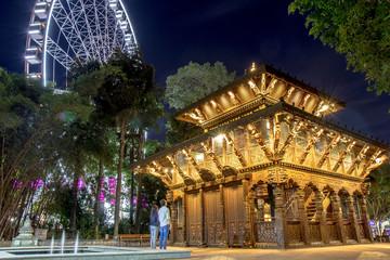 Travelers explore beautiful garden in night time