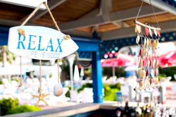 """bar on the beach decorated with seashells and inscription """"relax"""" in a hotel on the territory of Albania, the Adriatic coast"""