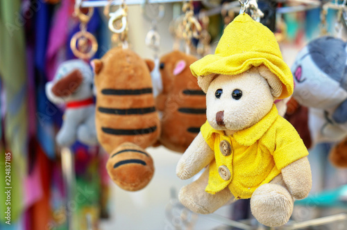 A Small Teddy Bear In A Yellow Jacket And Hat Stock Photo And