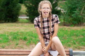fan nerd girl in short dress in a defiant pose